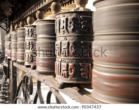 Prayer wheels at swayambhunath monkey temple in Kathmandu, Nepal - stock photo