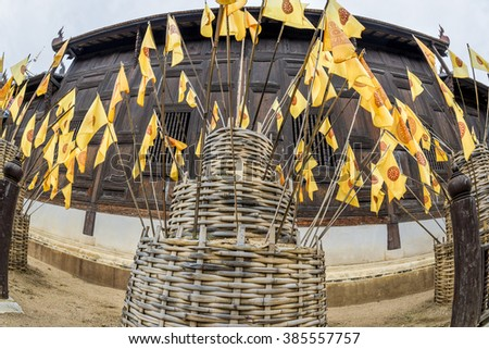Prayer Yellow flag logo pattern Dharmachakra (Wheel of Dhamma) Buddhism the flags decorate  in the temple on Songkran Festival is celebrated ot Thai traditional New Year's Day.  - stock photo