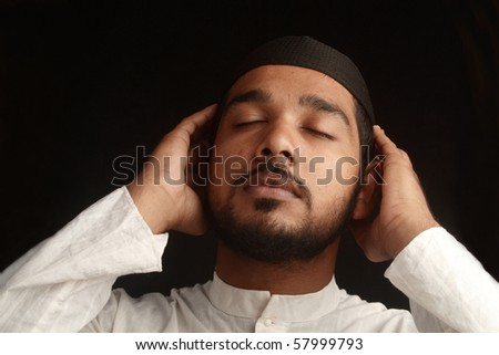 Praying gestures of a Muslim - stock photo