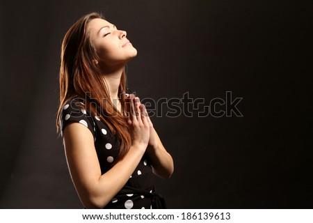 praying girl  - stock photo