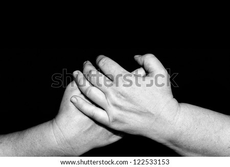 Praying hands of woman in black - stock photo