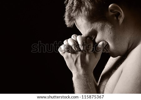 Praying man. OTHER PHOTOS FROM THIS SERIES IN MY PORTFOLIO. - stock photo