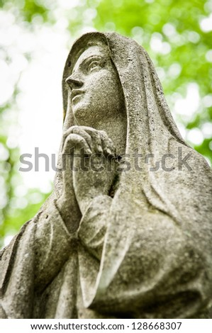 praying mary at an old cemetry - stock photo