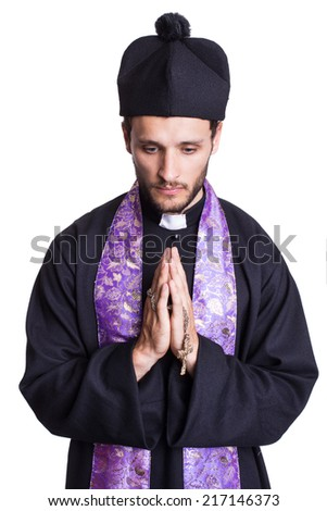Praying priest. Studio portrait isolated on white background   - stock photo