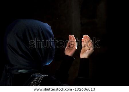 praying woman - stock photo