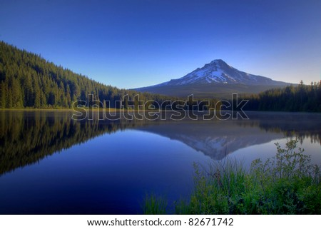 Pre Dawn Image Of Snow Capped Mount Hood Reflecting Off The Glass Smooth Surface Of Lake Trillium In Oregon In The Pacific Northwest. - stock photo