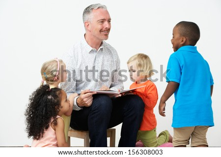 Pre School Teacher Reading Story To Children - stock photo