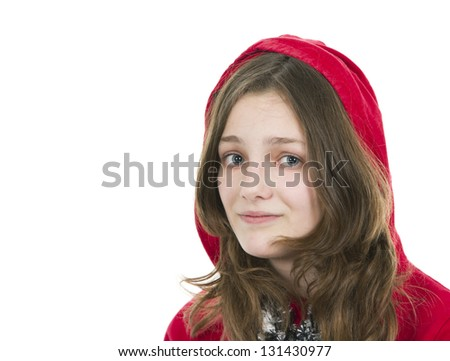 Pre teen young girl in a red hooded top on white background - stock photo