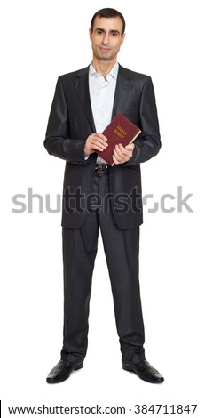 Preacher man portrait in black suit with bible book on white at studio - stock photo
