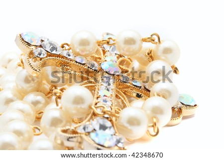 precious jewelery cross with pearls - stock photo