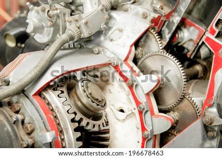 precision mechanics inside a vintage aircraft engine - stock photo