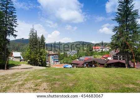 PREDEAL, ROMANIA - MAY 30, 2016: View of the tourist town of Predeal, Romania in a sunny day - stock photo