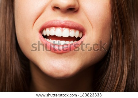 prefect teeth of a pretty girl closeup - stock photo