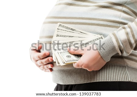 Pregnancy and surrogacy concept - pregnant woman hand holding dollar currency cash - stock photo