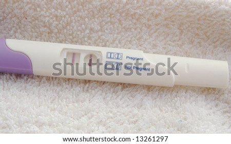 pregnancy test kit showing positive - stock photo