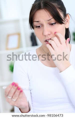 Pregnancy test  worry , upset woman with  positive result - stock photo