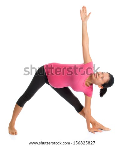 Pregnancy yoga class. Full length healthy Asian pregnant woman doing yoga exercise stretching, full body isolated on white background. Yoga positions triangle pose. - stock photo