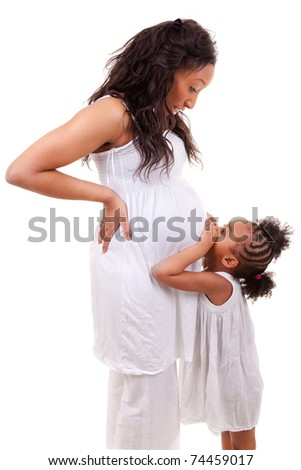 Pregnant black woman with her daughter - stock photo
