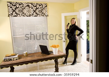 Pregnant business woman entering her home office - stock photo