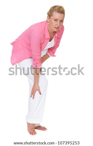 Pregnant female suffer from calf pain isolated on white - stock photo