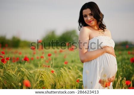 pregnant gorgeous brunette woman - stock photo