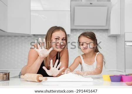 pregnant in the kitchen with the family cook to eat - stock photo