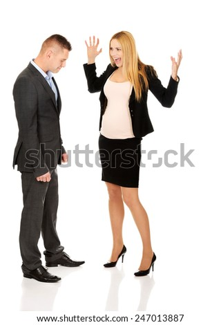 Pregnant woman arguing with her business partner - stock photo