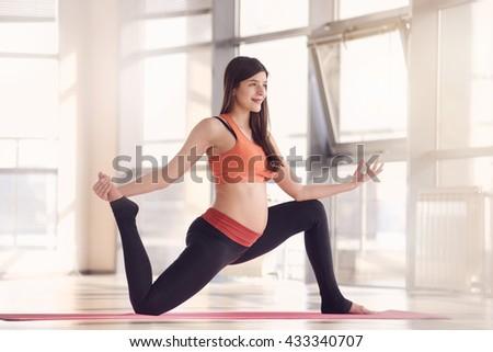 pregnant woman gym fitness exercise - stock photo