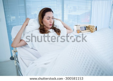 Pregnant woman having birth pangs in hospital room - stock photo