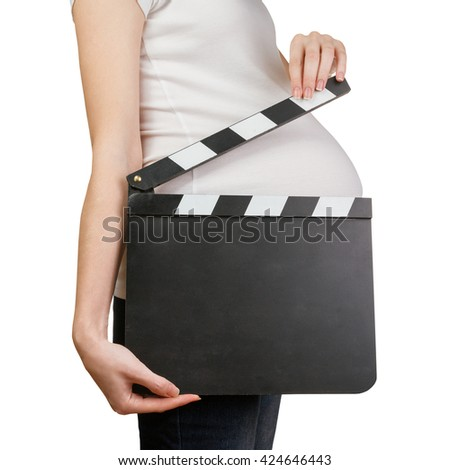Pregnant woman holding blank clapperboard isolated on white background - stock photo