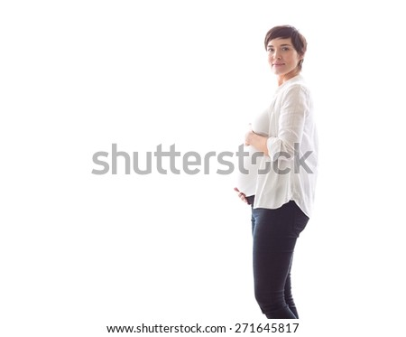 Pregnant woman holding her bump on white background - stock photo