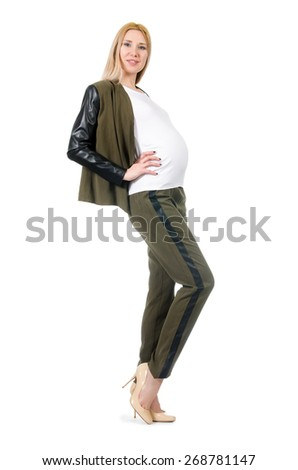 Pregnant woman in fashionable costume isolated on white - stock photo