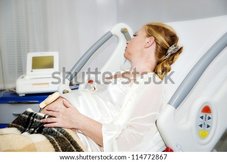 Pregnant woman in hospital - stock photo