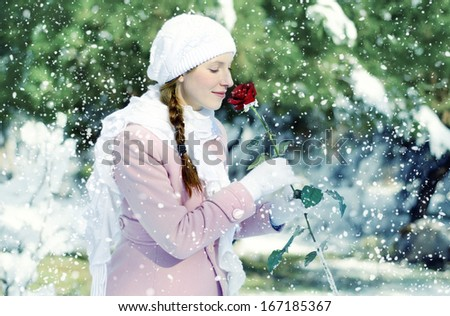 pregnant woman in winter park - stock photo