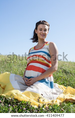 pregnant woman outdoor nature - stock photo