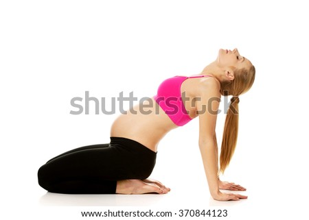 Pregnant woman relax doing yoga - stock photo