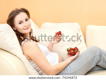 pregnant woman relaxing at home - stock photo