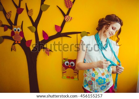 pregnant woman standing near the interesting  tree - stock photo