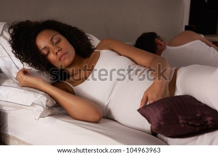 Pregnant woman trying to sleep - stock photo