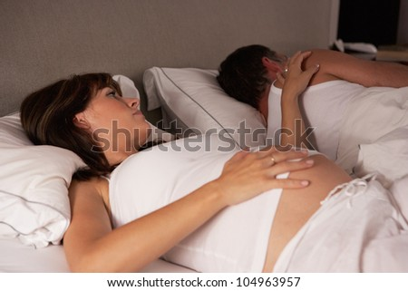 Pregnant woman unable to sleep - stock photo