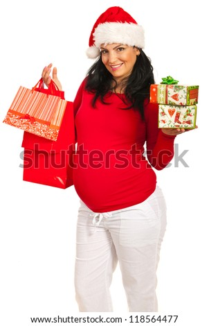 Pregnant woman with Christmas shopping bags and presents isolated on white background - stock photo