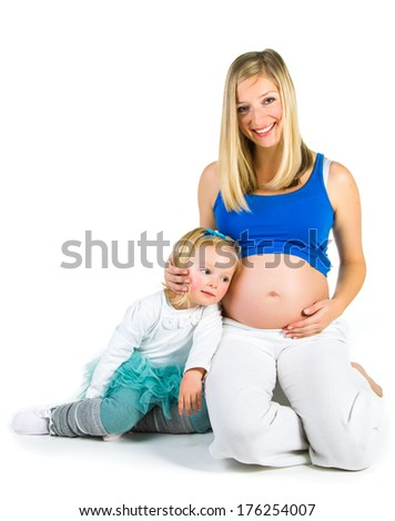 Pregnant woman with daughter on white - stock photo
