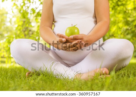 Pregnant woman with fresh green apple.Pregnancy, healthcare, food and happiness concept.Healthy pregnancy. - stock photo