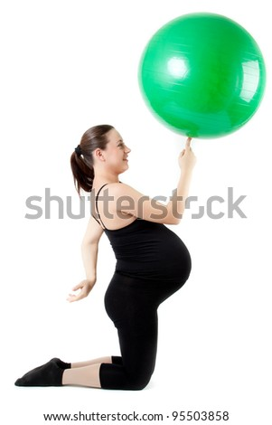 Pregnant woman with gymnastic ball. Beautiful pregnant woman sitting with exercise bal. Isolated on white background. - stock photo