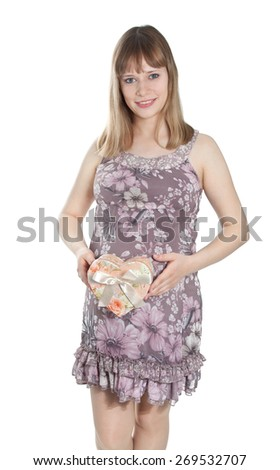 Pregnant woman with heart-shaped box smiling - stock photo