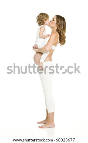 Pregnant woman with her daughter isolated on white background - stock photo