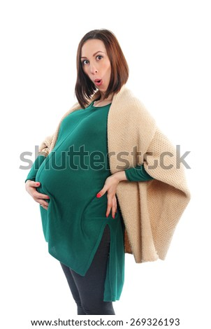Pregnant young woman - stock photo