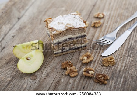 Prekmurska hibanica over mura moving layered cake on wooden surface - stock photo