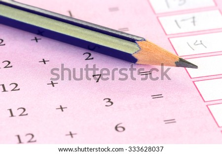 Preliminary mathematics with a pencil - stock photo