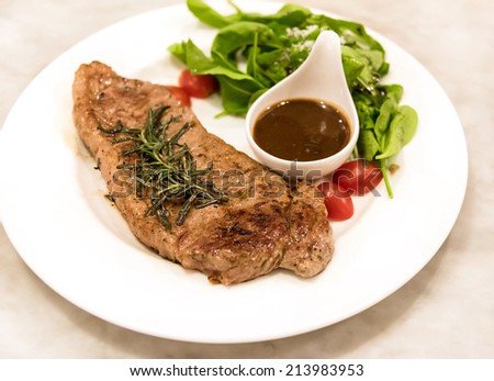 Premium ribeye steak on a well decorated dish ready to serve - stock photo